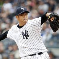 Gets the job done: New York's Hiroki Kuroda throws a pitch against Baltimore in the first inning on Monday. The Yankees downed the Orioles 4-2. | AP