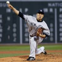 Sock it to 'em: New York starter Masahiro Tanaka pitches in the first inning of the Yankees' 9-3 win over the Red Sox on Tuesday. | AP