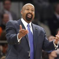 Jackson starts house cleaning with Knicks by firing Woodson