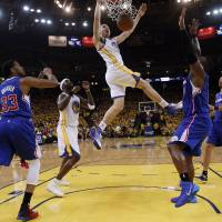 Between the lines: The Warriors' Klay Thompson dunks against the Clippers during Game 4 of their first-round series on Sunday in Oakland, California. | AP