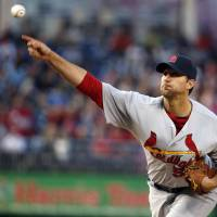 Sublime: St. Louis starter Adam Wainwright throws a pitch against Washington in the first inning on Thursday night. | AP