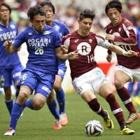 Hired gun: Much-traveled striker Marquinhos (right) has helped Vissel Kobe move to the top the J. League table. | KYODO