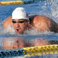 Phelps finishes second behind Lochte in 100m butterfly