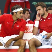 What just happened?: Switzerland's Roger Federer (left) and Stanislas Wawrinka talk during their Davis Cup doubles loss against Kazakhstan on Saturday in Geneva. | AP