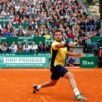 Swiss roll: Stanislas Wawrinka plays a shot during his 4-6, 7-6 (7-5), 6-2 victory over Swiss compatriot Roger Federer in the final of the Monte Carlo Masters on Sunday. | AP