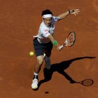 Reach for it: Kei Nishikori plays a shot against Santiago Giraldo on Sunday in Barcelona, Spain. | AFP-JIJI