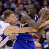 Safe haven: Los Angeles' Blake Griffin (left) tries to steal the ball from Golden State's Draymond Green on Tuesday. | AP