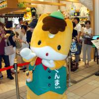 Feeling neigh-borly: Gunma-chan, the horse mascot for Gunma Prefecture, welcomes customers to a specialty store in Takasaki Station last year. | KYODO