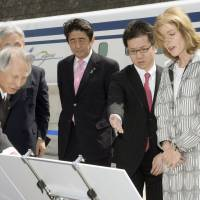Abe, Kennedy hitch maglev ride