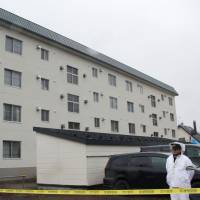 This dormitory for police officers was damaged by a suspected serial bomber in Sapporo on April 3. | KYODO