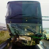 Eight hurt after bus jumps barrier