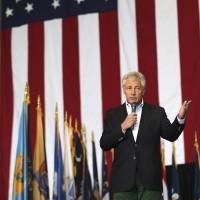 U.S. Defense Secretary Chuck Hagel delivers a speech to U.S. military personnel at Yokota Air Base in western Tokyo on Saturday. | AP