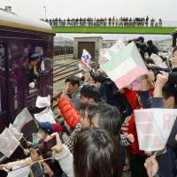 A train commemorating the full recovery of Sanriku Railway's Minami-Riasu Line departs Sakari Station on Saturday. | KYODO