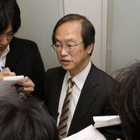 Hideo Miki, one of the lawyers representing Riken institute researcher Haruko Obokata, speaks to reporters in the city of Osaka on Monday after submitting documents defending his client, who stands accused of research misconduct. | KYODO