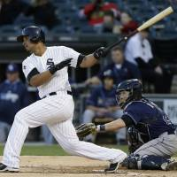 Abreu slam lifts White Sox