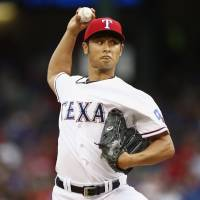 Darvish stifles Astros; Rangers win in 12th