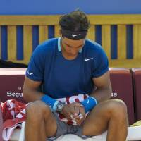 Hard to take: Rafael Nadal (above) slumps in his chair after his loss to compatriot Nicolas Almagro at the Barcelona Open on Friday. | AFP-JIJI