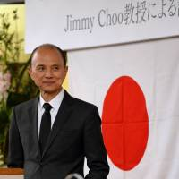 Malaysian designer Jimmy Choo listens to a question during his Creativity Through Skills lecture in Fukushima on April 18. | AFP-JIJI