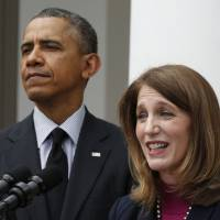 U.S. President Barack Obama listens to Sylvia Mathews Burwell speak after nominating her to become secretary of health and human services at the White House on Friday. | REUTERS