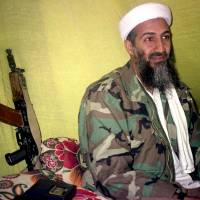 Al-Qaida leader Osama Bin Laden speaks to reporters in Afghanistan's Helmand province in December 1998. | AP