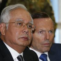 Malaysian Prime Minister Najib Razak and Australian Prime Minister Tony Abbott are briefed April 3.  | REUTERS