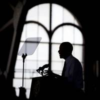 President Barack Obama speaks at the University of Michigan on Wednesday about his proposal to raise the national minimum wage. | AP