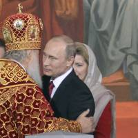Russian Orthodox Patriarch Kirill congratulates President Vladimir Putin during a service for the celebration of the Orthodox Easter in Moscow on April 20. | AFP-JIJI