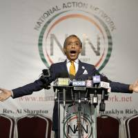 Rev. Al Sharpton speaks during a news conference in New York on Tuesday. Sharpton says a report that he spied on New York mafia figures for the FBI in the 1980s is old news, and that he ought to be seen as a victim in the investigation. | AP