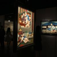 Pieces from an exhibition titled 'Gardens of Pleasure: Sex in Ancient China,' spanning the Han to Qing dynasties, are displayed by Sotheby's on Tuesday in Hong Kong. | REUTERS