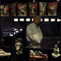 A visitor views erotic objects during a preview of an exhibition entitled 'Gardens of Pleasure: Sex in Ancient China' at Sotheby's Hong Kong Gallery on Tuesday. | REUTERS