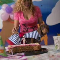 Valery Palma prepares to blow out the candle on a birthday cake for her 1-year-old dachshund, Camila, at the dog's April 6 birthday party in Mexico City. | AP