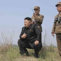 North Korean leader Kim Jong Un watches a rocket launching drill by women's subunits of the Korean People's Army in this photo released Thursday by official state media.   REUTERS