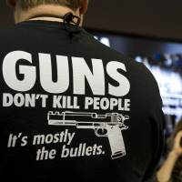 A convention attendee wears a gun-related T-shirt at the 143rd NRA Annual Meetings and Exhibits at the Indiana Convention Center in Indianapolis on Friday. | AFP-JIJI