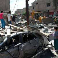 Dozens killed in Syria attacks; watchdog to probe gas claims
