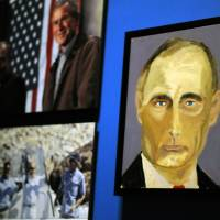 """A portrait of Russian President Vladimir Putin — part of the exhibit """"The Art of Leadership: A President's  Diplomacy"""" — are displayed at the George W. Bush Presidential Library and Museum in Dallas on Friday. The exhibit of portraits of world leaders painted by former President George W. Bush was to open Saturday and run through June 3. 