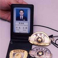 Badge of honor: Police officers in Japan are required to display badges upon request. Genuine badges have the name of the officer's prefecture etched into the ribbon. | KYODO