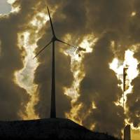 Shift to green energy would barely slow growth, U.N. report says