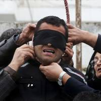 Iran mother spares life of son's killer after campaign