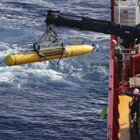The Bluefin-21 autonomous underwater vehicle is hoisted over the side of the Australian defense vessel Ocean Shield in the southern Indian Ocean during the continuing search for the missing Malaysian Airlines Flight MH370 on Thursday. | REUTERS