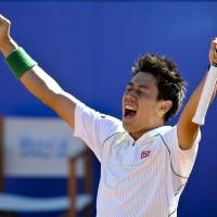 No doubt about it: Kei Nishikori celebrates after winning the Barcelona Open on Sunday. Nishikori defeated Santiago Giraldo 6-2, 6-2 to win his first title on clay. | AFP-JIJI
