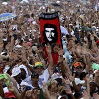 A crowd of cheering fans attend the Peace Without Borders concert in Revolution Square, Havana, in September 2009. According to a report Thursday, the U.S. government secretly masterminded the creation of a 'Cuban Twitter' to undermine the communist government in Havana. The peace concert was a perfect opportunity for the U.S. to test out the budding social network dubbed 'ZunZuneo,' Cuban slang for a hummingbird's tweet. | AP