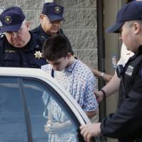 Alex Hribal, the suspect in a stabbing spree Wednesday at the Franklin Regional High School near Pittsburgh, is taken from a district magistrate after he was arraigned later that day in Export, Pennsylvania. | AP