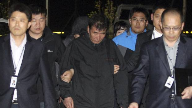 South Korean ferry captain arrested; divers spot bodies