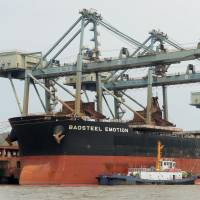 The Baosteel Emotion, a ship owned by Japanese shipping firm Mitsui O.S.K. Lines Ltd., is moored at a port in Zhejiang province on Tuesday. | KYODO