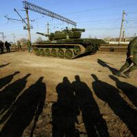 Russia withdraws some troops from Ukraine border