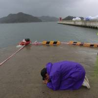 Bad weather hinders search for ferry dead