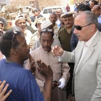 Aswan Gov. Mustafa Yousr (right) speaks with families and residents of the Nubian and the Arab Haleyla clans in the southern city of Aswan on Sunday. At least 25 people have now been killed in the violence between members of the city's two big tribes. | REUTERS