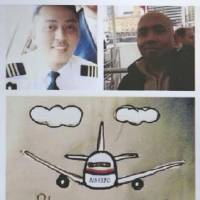 Photos of pilot Zaharie Ahmad Shah (top right) and co-pilot Fariq Abdul Hamid, who were onboard the missing Malaysia Airlines Flight MH370, are placed at Kechara Forest Retreat in Bentong, outside Kuala Lumpur, on Sunday. | AP