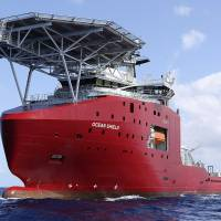 Australian Navy vessel Ocean Shield tows a pinger locator in the search for the missing Malaysia Airlines flight data recorder and cockpit voice recorder in the southern Indian Ocean on Friday. | AP