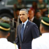 Analysis: Obama tries to balance Asia demands, global turbulence